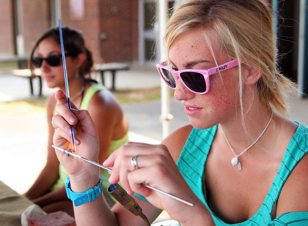 Newburyport: Kailey Burke, 17, of Haverhill, makes a glass bead at her booth for KBeads at Tuesday's Skatefest at the Newburyport Skate Park. Photo by Ben Laing/Staff Photo