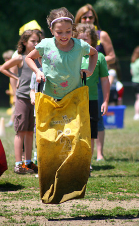 Newburyport: Third grader Molly Balentine participates in the sack race during Tuesday afternoon's third grade celebration at the Bresnahan Elementary School in Newburyport. Photo by Ben Laing/Staff Photo