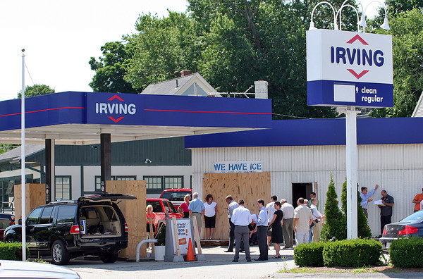 Newburyport: The former Irving gas station on the corner of Merrimac and Kent streets was up for auction Tuesday morning, with a crowd of potential buyers lined up outside. Photo by Ben Laing/Staff Photo