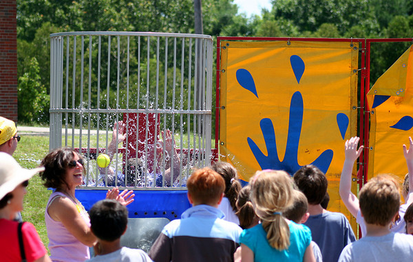 Newburyport: Bresnahan Elementary School assistant principal William McGowan gets dunked by a third grade student during Tuesday's 3rd grade celebration day. Photo by Ben Laing/Staff Photo