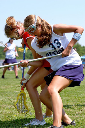 Byfield: Triton's Alison Towns (33) battles with an Ipswich player during Wednesday's 14-10 win over the Tigers in Byfield. Photo by Ben Laing/Staff Photo