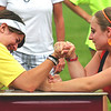 Amesbury: Ray Jeselonis, left, struggles in an arm wrestling match with fellow eight grader Ali Debasitis during Amesbury Middle School's field day Monday morning. Photo by Ben Laing/Staff Photo