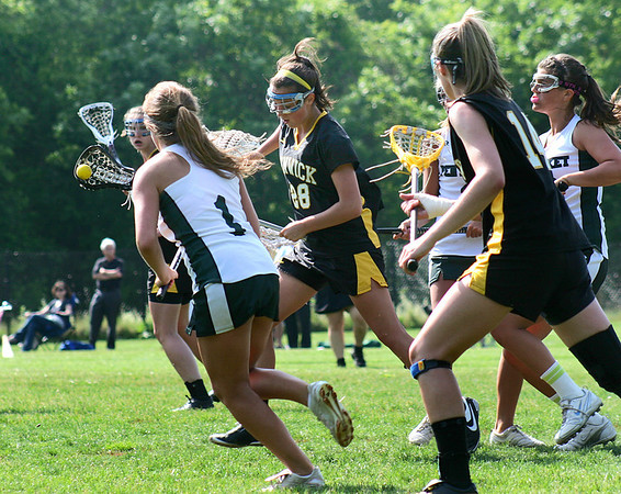 West Newbury: Bishop Fenwick's Kayla Caruso (28) tries to carry the ball through the Pentucket defenders during Wednesday's game in West Newbury. Photo by Ben Laing/Staff Photo