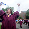 "Byfield: Cody Ferriero of Essex Ma. celebrates after jumping the wall, a tradition at the Governor's Academy Commencement. Cody and some of his fellow graduates donned snorkles and flippers to make the leap as "" protection"" from the rain. Jim Vaiknoras/Staff photo"