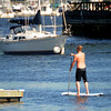 newburyport; A paddle boarder makes his way towards the Gillis Bridge in newburyport Saturday morning. Jim Vaiknoras/Staff photo