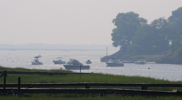 Newbury: Smoke from forest fires in Quebec settle over the Parker River in Newbury Monday morning. JIm Vaiknoras/Staff photo
