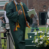 West Newbury: Pentucket graduate Cameron Spofford give the thumbs up after getting his diploma at commencement Saturday morning in West Newbury. Jim Vaiknoras/Staff photo