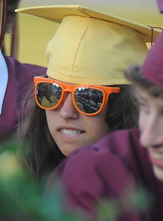 Newburyport: Newburyport High senior Bridget Evangelista wore her sunglasses to graduation at World War Memorial Stadium in Newburyport Monday night. Jim Vaiknoras/Staff photo