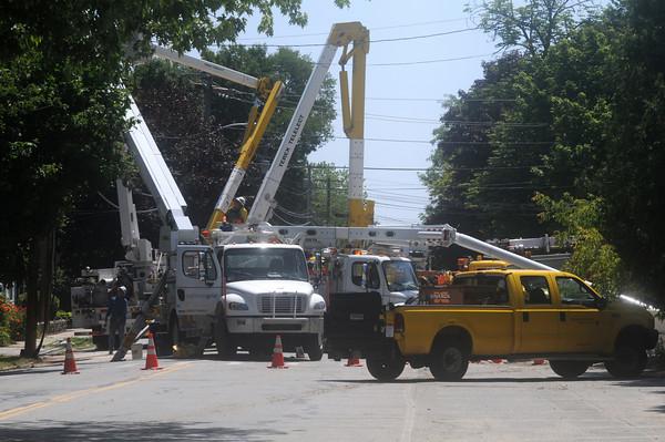 Newburyport: Worker repair  a utility pole that was damaged on Merrimac Street in Newburyport Friday morning. Jim Vaiknoras/Staff photo