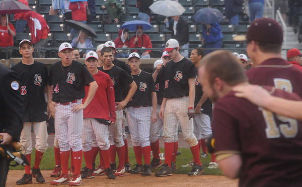 Lowell: Amesbury players line up after their 6-0  loss to Whittier Saturday at LeLacheur Park in Lowell. Jim Vaiknoras/Staff photo