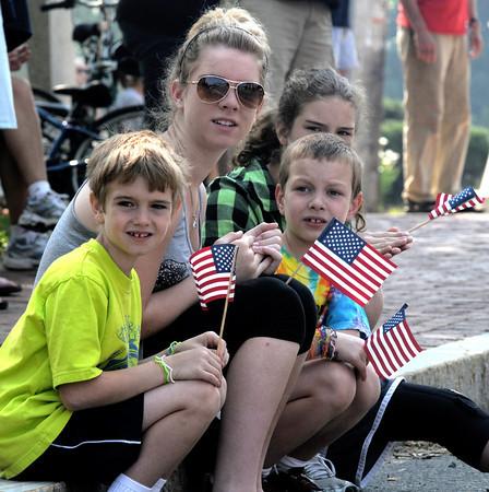 Amesbury: Sean McCann, 7, his sister Kristina, 14, cousin Spencer Butzen, 7 and sister Allison McCann, 12, watch the Amesbury Memorial Day parade on School Street Monday morning. Jim Vaiknoras/Staff photo