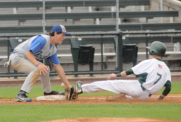 Lowell: Georgetown's Chris L'Italien can't hang on to the ball as  Matignon's Colin Smith slides safety into 3rd  during their game at LeLacheur Park in Lowell.Matignon won the North Sectional Championship 9-2. Jim Vaiknoras/Staff photo