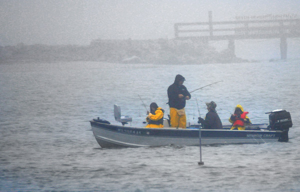 Seabrook: A group of fishermen try their luck in Seabrook Harbor on a very foggy Sunday afternoon. Jim Vaiknoras/Staff photo