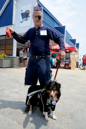 salisbury:Paul Taylor of Lowell dressed himself and his dog King for the Sand and Sea Festival annual Pet Parade at Salisbury Beach Center  this weekend. Jim Vaiknoras/Staff photo