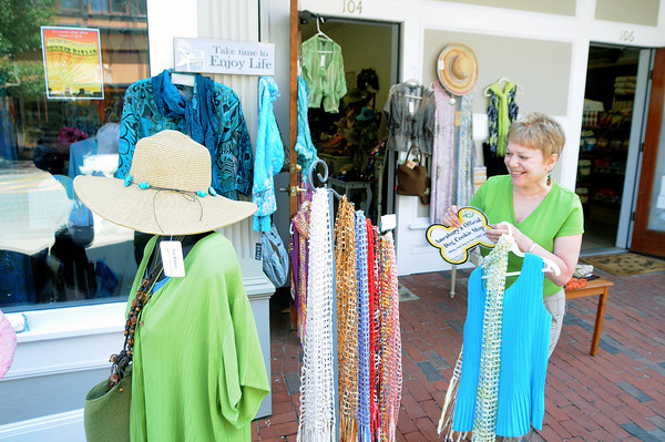 Amesbury: Marge Crosby sets up for the Amesbury Days sidewalk sale at The C Meadows on main Street in Amesbury Friday. Jim Vaiknoras/Staff photo