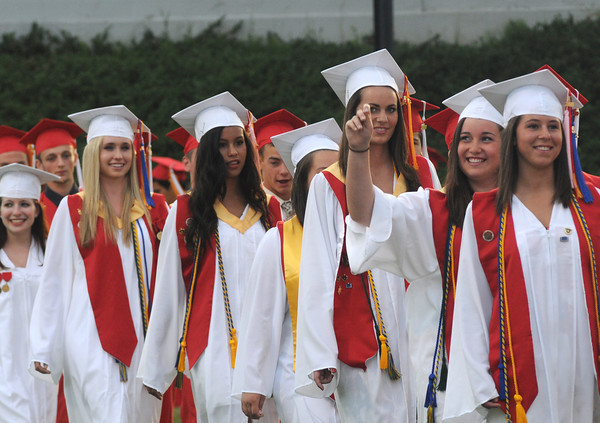 Amesbury: Amesbury High Class of 2010 march into Laundry Stadium for  Graduation  Friday night. Jim Vaiknoras/Staff photo