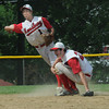 Amesbury: Amesbury's Tyler Lee ducks as teammate Joseph Mejia throws out a runner Saturday . Jim Vaiknoras/Staff photo