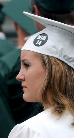 West Newbury:Like many of her classmates Pentucket graduate Sarah Soucy wore a sticker in memory of Matt McCarthy, a member of the class of 2010 who died earlier this year, at commencement Saturday morning in West Newbury. Jim Vaiknoras/Staff photo