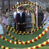 "Newburyport: Newburyport High seniors enter though the "" Junior Arch of Roses"" during graduation at World War Memorial Stadium in Newburyport Monday night. Jim Vaiknoras/Staff photo"