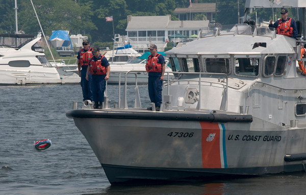 Newburyport:Members of the Coast Guard honor the fallen with a wreath  during the Newburyport Memorial Day ceremony  Monday.  Jim Vaiknoras/Staff photo