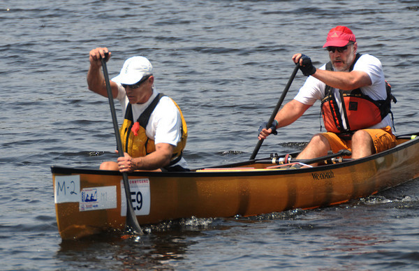 Amesbury: The team of Shawn Burke of North Andover and Kirk Olson of Andover were the first to cross the finish line in the annual Canoe Race on Lake Gardner in Amesbury Saturday. Jim Vaiknoras/Staff photo