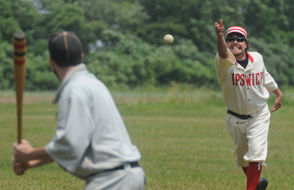 Newbury: Mike Higgins of Ipswich pitches one to an Essex batter during their game of 1861 rules baseball at the Spencer-pierce Little farm in Newbury Sunday. Jim Vaiknoras/Staff  photo