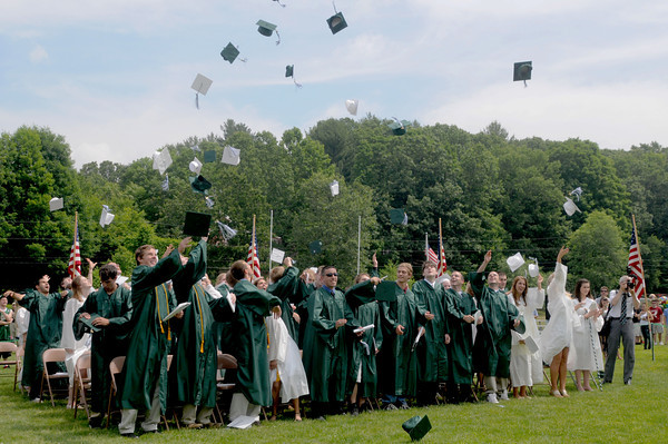 west Newbury: Pentucket graduates toss their caps in celebration at the end of commencement Saturday morning in West Newbury. Jim Vaiknoras/Staff photo