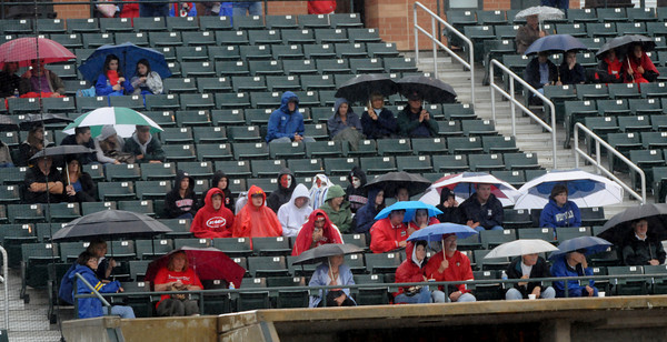 Lowell: Amesbury fans came prepared for the rain as they watch their Indians fall to Whittier 6-0 Saturday at LeLacheur Park in Lowell. Jim Vaiknoras/Staff photo