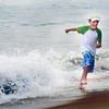 Salisbury: Morgan Souther, 8, gets runs from a wave on Salisbury Beach Sunday morning. Jim Vaiknora/Staff photo