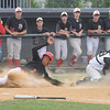 lowell:  Bishop Fenwick's Joe Bona field a late throw as  Amesbury's Joseph Mejia slides safely home at Alumni Field in Lowell Wednesday night. Jim Vaiknoras/Staff photo