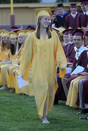 Newburyport: Rachel Notargiacomo is all smiles after getting her diploma during graduation at World War Memorial Stadium in Newburyport Monday night. Jim Vaiknoras/Staff photo