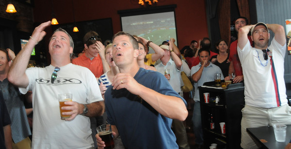 Newburyport: Soccer fans Lee Willingham, Jason Moore and Andy Simpter react in disbelief at the Port Tavern in Newburyport as Ghana scores in extra time to eliminate The USA from the World Cup. Jim Vaiknoras/Staff photo