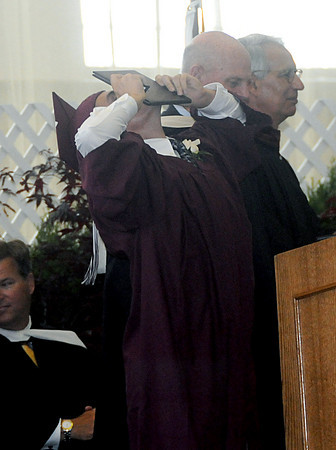 Byfield: Lucas Montoni of Newburyport kisses his diploma at the Governor's Academy Commencement Sunday morning.  Jim Vaiknoras/Staff photo