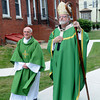 Amesbury, Cardinal Sean O'Malley walks with Deacon Ray Doucette before saying Mass at Holy Family Church in Amesbury Saturday afternoon. The cardinal was in Amesbury to  dedicate the new Parish Center at the church. Jim Vaiknoras/Staff photo