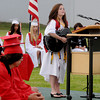 Amesbury: Amesbury High Class President Renee Pelletier sings a song she wrote to her classmates at Graduation at Landry Stadium Friday night. Jim Vaiknoras/Staff photo