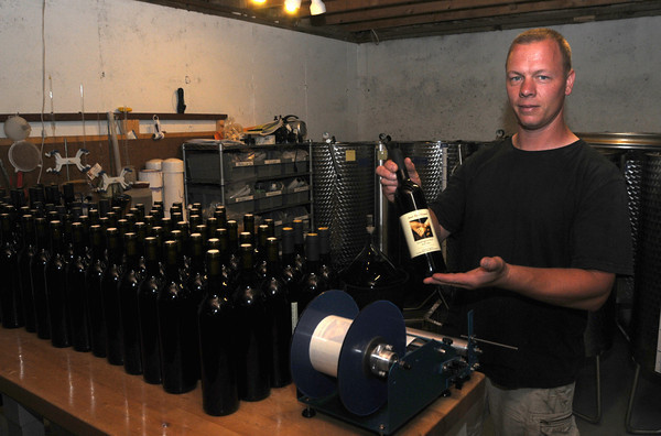 Kensington: Lewis Eaton of Sweet Baby Vineyards in Kensington labels some of his product. Jim Vaiknoras/Staff photo