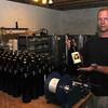 Kensington: Lewis Eaton of Sweet Baby Vineyards in Kensington labels some of his product. Jim Vaiknoras/Staff photo