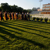 Newburyport: Newburyport High seniors cast long shadows in the late afternoon sun as they march in during graduation at World War Memorial Stadium in Newburyport Monday night. Jim Vaiknoras/Staff photo
