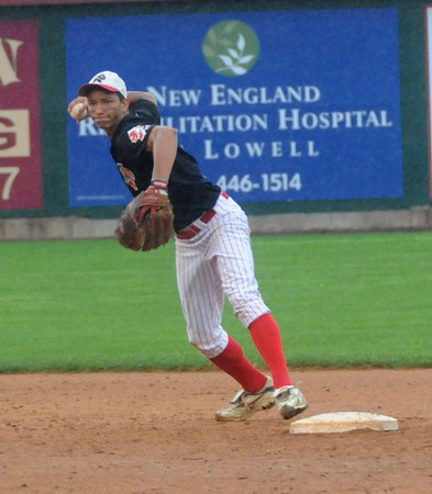 Lowell: Amesbury's Joseph Mejia throws out a batter at first during the Indian's 6-0 loss to Whittier Saturday at LeLacheur Park in Lowell. Jim Vaiknoras/Staff photo