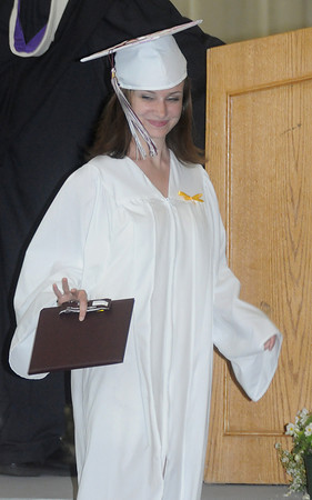 Byfield: Annie Quigley of Byfield gives a little wave after getting her diploma at the Governor's Academy Commencement. Jim Vaiknoras/Staff photo