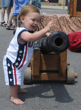 salisbury:Joseph Flynn, 10 months, plays with one of the pirate cannons  the Sand and Sea Festival at Salisbury Beach Center  this weekend. Jim Vaiknoras/Staff photo
