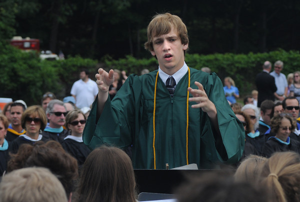 West Newbury: Pentucket graduate Kevin Dacey conducts the school concert band at commencement Saturday morning in West Newbury. Jim Vaiknoras/Staff photo