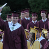 Newburyport: Eric Kretsch hold up his diploma during graduation at World War Memorial Stadium in Newburyport Monday night. Jim Vaiknoras/Staff photo