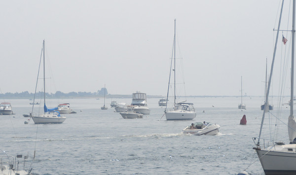 Newburyport: A light haze move up the Merrimack River as boaters make their way out Sunday morning. Jim Vaiknoras/Staff photo