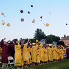 Newburyport: Newburyport high seniors toss their caps in celebration at the end of graduation at World War Memorial Stadium Monday night. Jim Vaiknoras/Staff photo