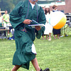 West Newbury: Pentucket graduate Evan Miller kicks a beach ball the was being tossed around after getting his diploma at commencement Saturday morning in West Newbury. Jim Vaiknoras/Staff photo