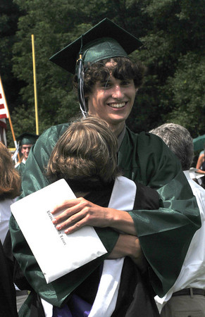 West Newbury: Pentucket graduate Brandon Lozier hugs class advisor Janet Eppoliti after getting his diploma at commencement Saturday morning in West Newbury. Jim Vaiknoras/Staff photo