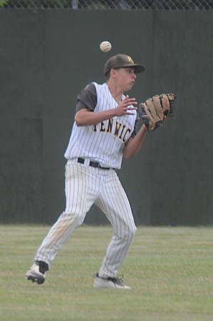 lowell:  Bishop Fenwick's Alex Morsey can't get a hold of a fly ball against Amesbury  at Alumni Field in Lowell Wednesday night. Jim Vaiknoras/Staff photo