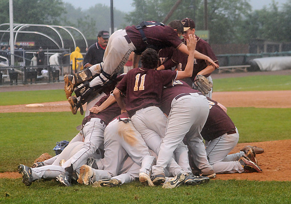 Lowell: Whittier celebrates their 6-0 defeat of Amesbury Saturday at LeLacheur Park in Lowell. Jim Vaiknoras/Staff photo