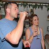 Kensington:  Rob Caloro and Tracy Trainor sample a glass of wine at one of Sweet Baby Vineyards in Kensington weekend wine tastings. Jim Vaiknoras/Staff photo